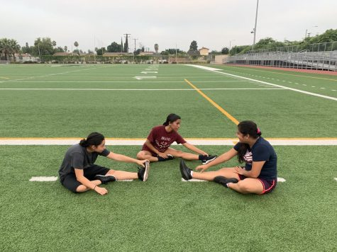 Football players practice on and off the field