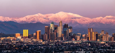 Downtown, Los Angeles, with a beautiful background of the snowy mountains.