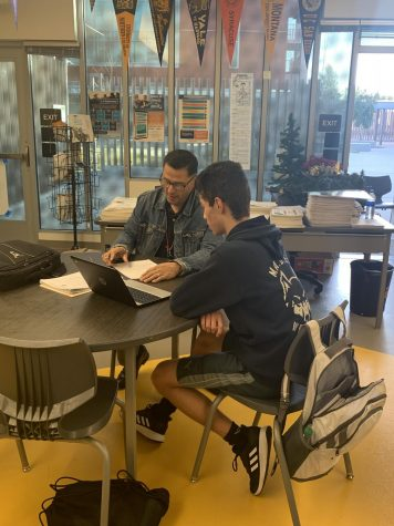 Signing Of: Jose Romero getting his paperwork in for golf.