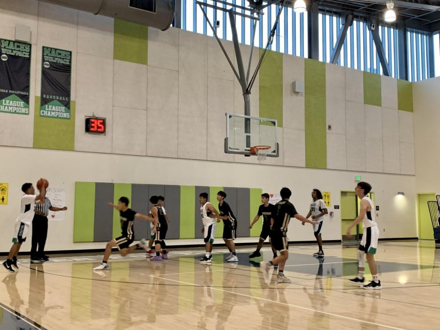 THE PACK PLAYS ON- MACES boys basketball played their last home game of the season on June 3rd. Senior David Torres fires a three to close out the playoff win against Panorama.