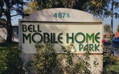 """As the City of Bell aims to sell two major mobile home parks and displace hundreds of families, the mobile home residents fight back with organization, demonstration, meeting with council members, and even going as far as to create their own certified non-profit organization, known as the New Dawn of Bell Home Owner Association, in hopes that they could purchase the property themselves. As new developments begin to pop up, for example, Border X Brewery and Tesla charging stations which are located on Pine and Gage in the City of Bell, residents should begin to worry that their low-income and predominantly Hispanic neighborhood may soon be taken over by a new crowd. """"...Los que vivimos aquí en las mobile homes...nos están discriminado, porque? Porque somos familias de bajo recursos. Aquí la mayoría somos hispanos, por eso, yo creo, [Those who live here in the mobile homes… they are discriminating us, why? Because we are low-income families. The majority of residents here are Hispanic, that's why,] said Merli Albizurez, Vice President of the New Dawn of Bell Home Owner Association. (Alejandra A. Martinez)"""