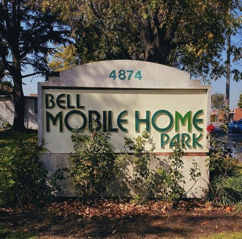 """As the City of Bell aims to sell two major mobile home parks and displace hundreds of families, the mobile home residents fight back with organization, demonstration, meeting with council members, and even going as far as to create their own certified non-profit organization, known as the New Dawn of Bell Home Owner Association, in hopes that they could purchase the property themselves. As new developments begin to pop up, for example, Border X Brewery and Tesla charging stations which are located on Pine and Gage in the City of Bell, residents should begin to worry that their low-income and predominantly Hispanic neighborhood may soon be taken over by a new crowd. """"...Los que vivimos aquí en las mobile homes...nos están discriminado, porque? Porque somos familias de bajo recursos. Aquí la mayoría somos hispanos, por eso, yo creo, [Those who live here in the mobile homes… they are discriminating us, why? Because we are low-income families. The majority of residents here are Hispanic, thats why,] said Merli Albizurez, Vice President of the New Dawn of Bell Home Owner Association. (Alejandra A. Martinez)"""